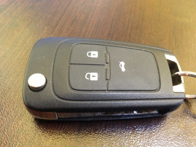 Cheie pliabila Opel Insignia cu buton portbagaj GM
